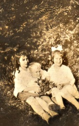 family archives circa 1921 Bonny bairns, Louise on left ( holding little brother) died very young, Catherine on right lived to ripe old age. I hope they all had many moments of happiness as this photo represents