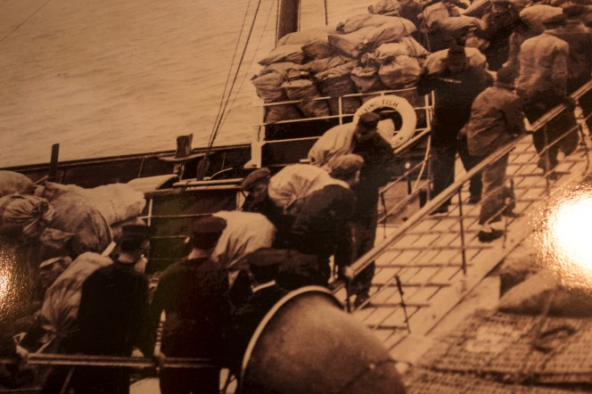 Fr. Browne photo of dock workers loading
